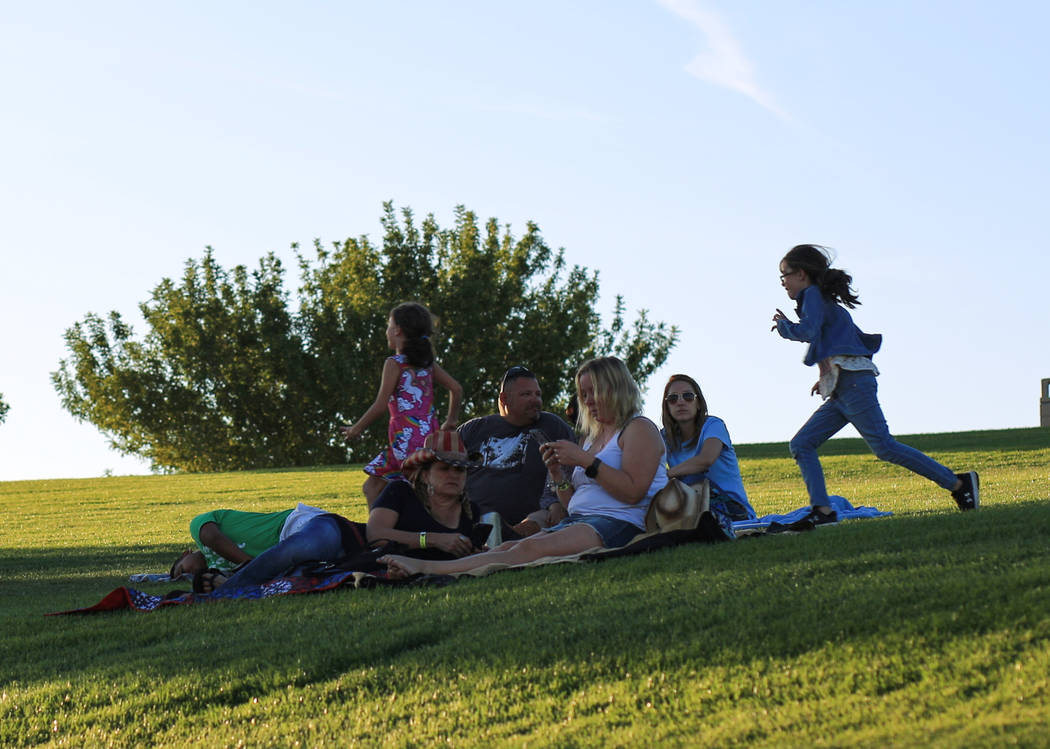 Kids play in the grass as spectators watch Nashville musician Alyssa Oeder perform a set during the Country 58 Benefit Concert at the Henderson Pavilion on Saturday, Oct. 27, 2018. The Country 58 ...