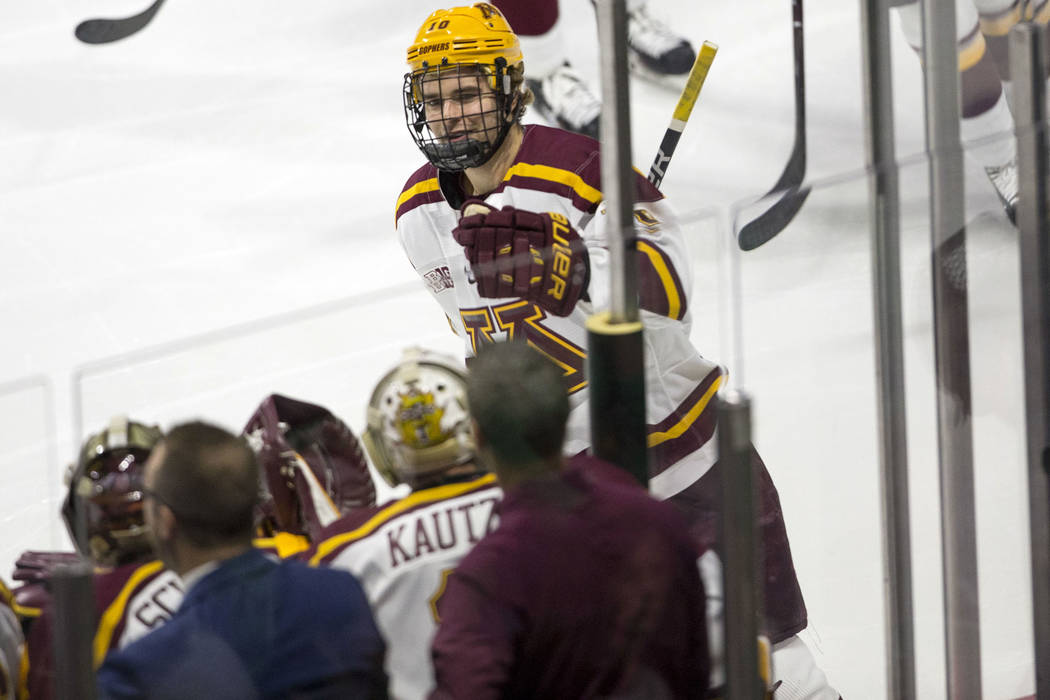 Minnesota Golden Gophers forward Brent Gates Jr. (10) celebrates his goal against the North Dakota Fighting Hawks during the second period of the U.S. Hockey Hall of Fame Game at the Orleans Arena ...