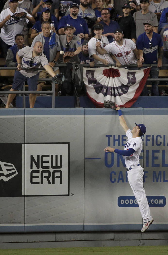 Los Angeles Dodgers center fielder Cody Bellinger can't get a glove on a Boston Red Sox's Steve Pearce home run during the eighth inning in Game 4 of the World Series baseball game on Saturday, Oc ...