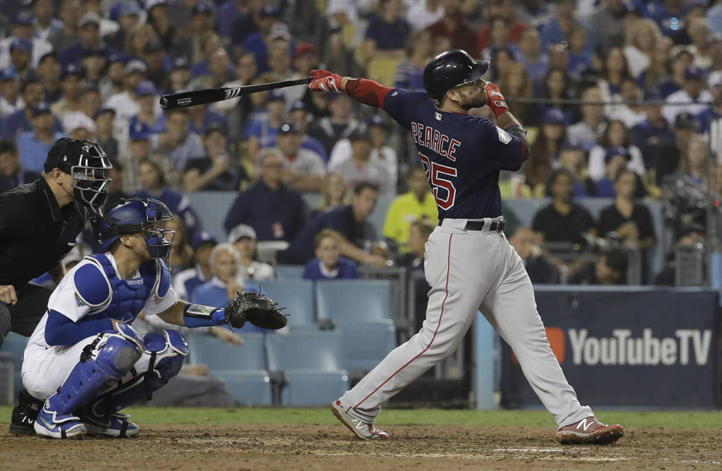 Boston Red Sox's Steve Pearce watches his solo home run to tie the game during the eighth inning in Game 4 of the World Series baseball game against the Los Angeles Dodgers on Saturday, Oct. 27, 2 ...