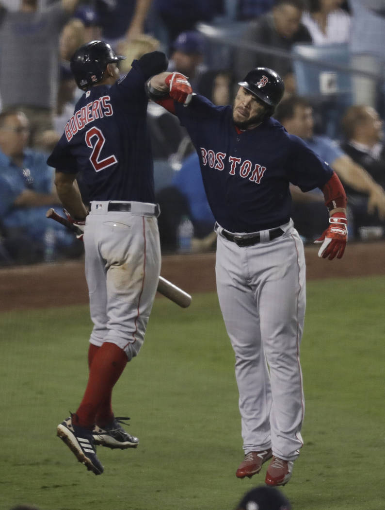 Boston Red Sox's Steve Pearce celebrates his solo home run to tie the game Xander Bogaerts with during the eighth inning in Game 4 of the World Series baseball game against the Los Angeles Dodgers ...