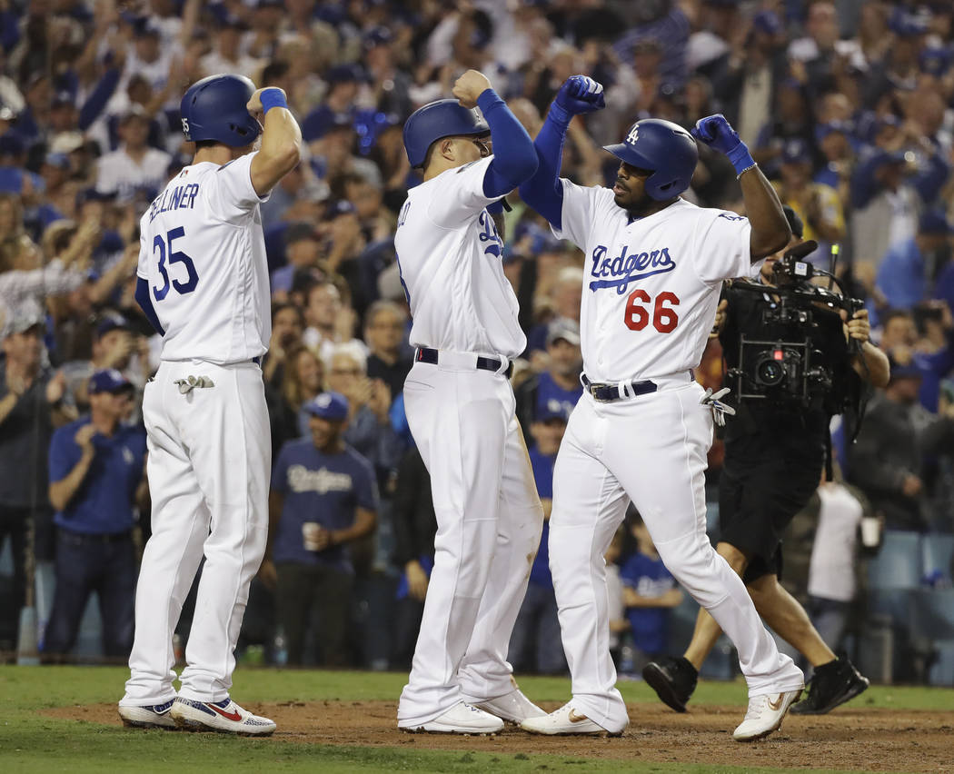 Los Angeles Dodgers' Yasiel Puig (66) celebrates with his teammates after hitting a three-run home run during the sixth inning in Game 4 of the World Series baseball game against the Boston Red So ...