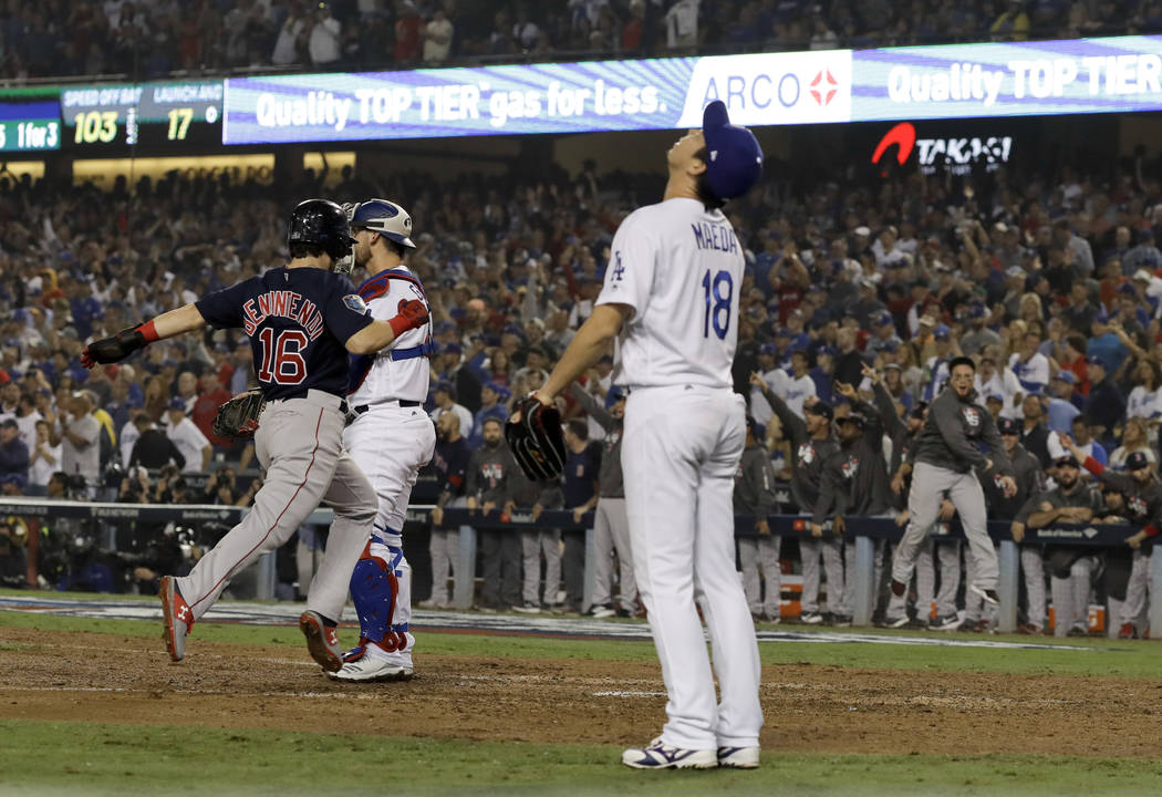 Los Angeles Dodgers pitcher Kenta Maeda looks up as Boston Red Sox's Andrew Benintendi scores on a three-run double by Steve Pearce during the ninth inning in Game 4 of the World Series baseball g ...