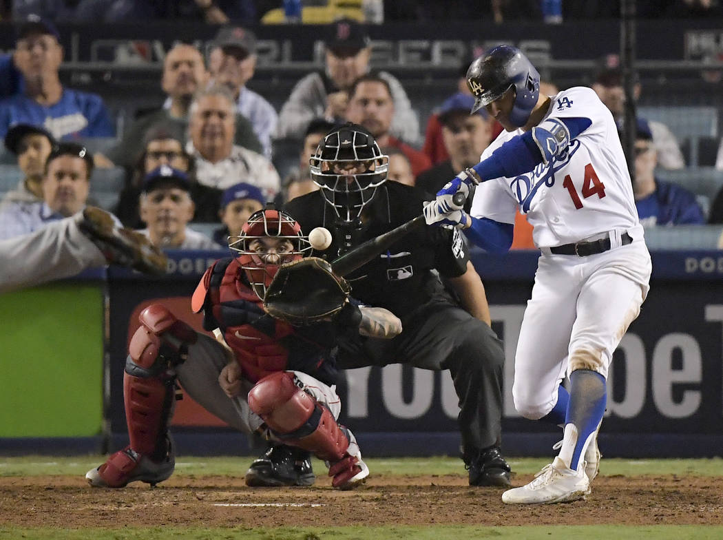 Los Angeles Dodgers' Enrique Hernandez hits two-run home run against the Boston Red Sox during the ninth inning in Game 4 of the World Series baseball game on Saturday, Oct. 27, 2018, in Los Angel ...