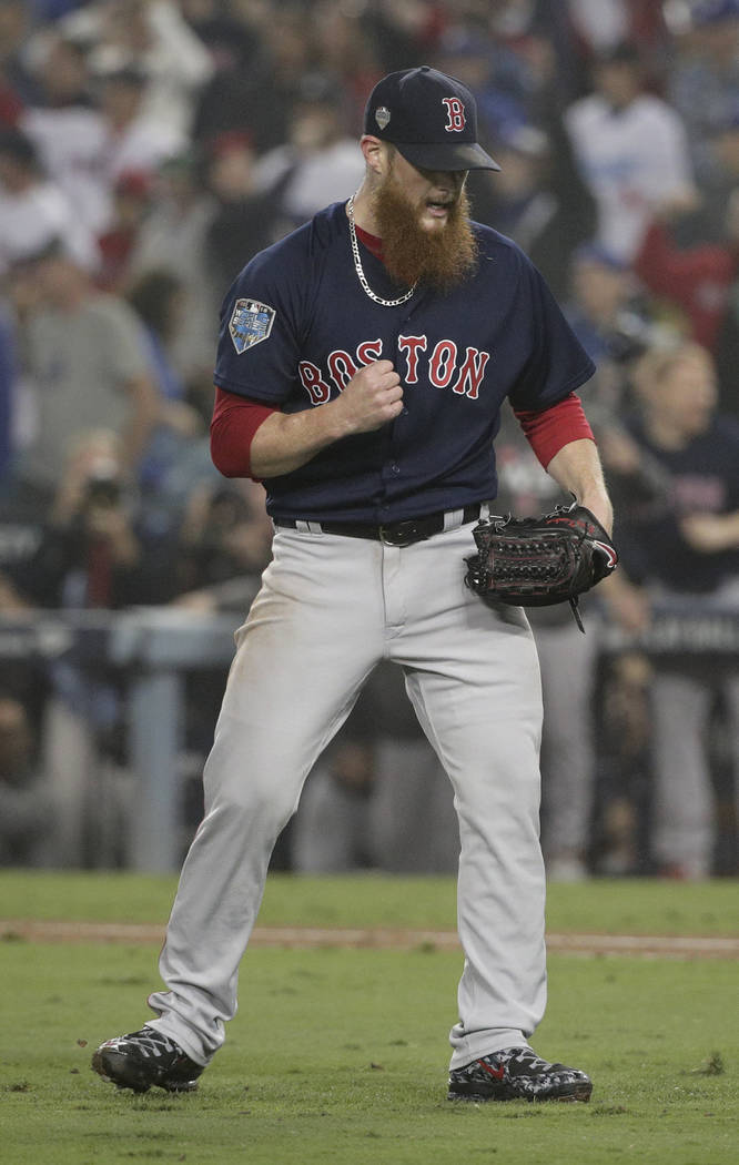 Boston Red Sox relief pitcher Craig Kimbrel celebrates after their win in Game 4 of the World Series baseball game against the Los Angeles Dodgers on Saturday, Oct. 27, 2018, in Los Angeles. The R ...