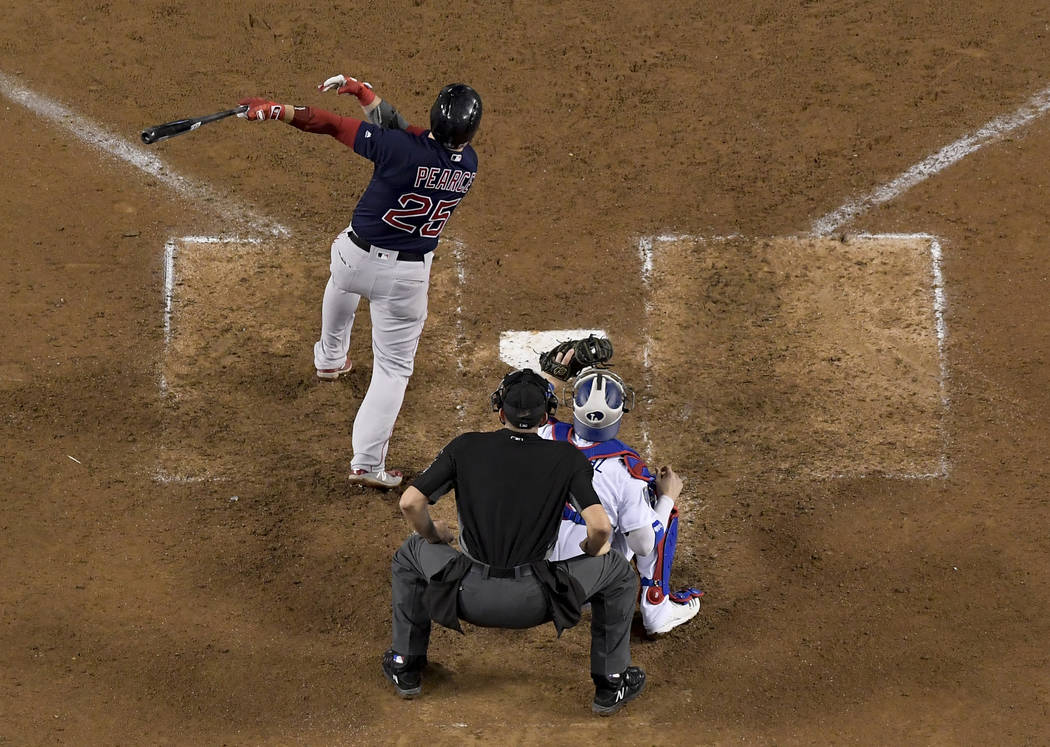 Boston Red Sox's Steve Pearce hits a three RBI-double against the Los Angeles Dodgers during the ninth inning in Game 4 of the World Series baseball game on Saturday, Oct. 27, 2018, in Los Angeles ...