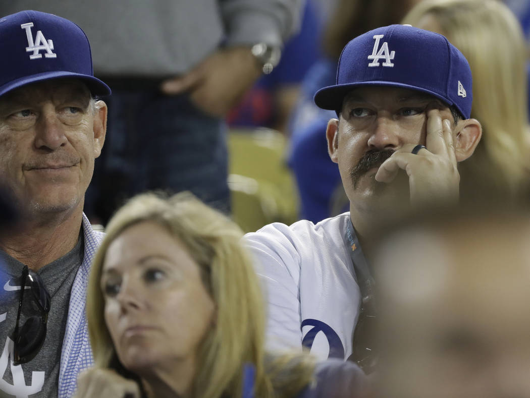 Los Angeles Dodgers fans watch Game 4 of the World Series baseball game between the Boston Red Sox and Los Angeles Dodgers on Saturday, Oct. 27, 2018, in Los Angeles. The Red Sox won 9-6. They lea ...