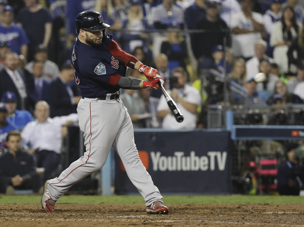 Boston Red Sox's Steve Pearce hits a three-run RBI double during the ninth inning in Game 4 of the World Series baseball game against the Los Angeles Dodgers on Saturday, Oct. 27, 2018, in Los Ang ...