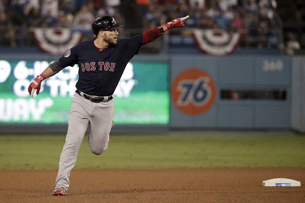 Boston Red Sox's Steve Pearce celebrates after his home run against the Los Angeles Dodgers during the eighth inning in Game 4 of the World Series baseball game on Saturday, Oct. 27, 2018, in Los ...