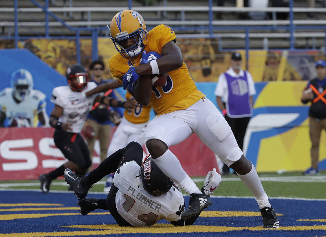 San Jose State wide receiver Tre Hartley, top, scores a touchdown against UNLV defensive back Myles Plummer (14) during the second half of an NCAA college football game in San Jose, Calif., Saturd ...