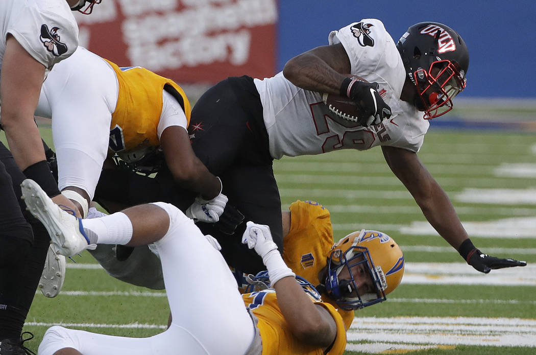 UNLV running back Evan Owens, top, is tackled against San Jose State during the second half of an NCAA college football game in San Jose, Calif., Saturday, Oct. 27, 2018. (AP Photo/Jeff Chiu)