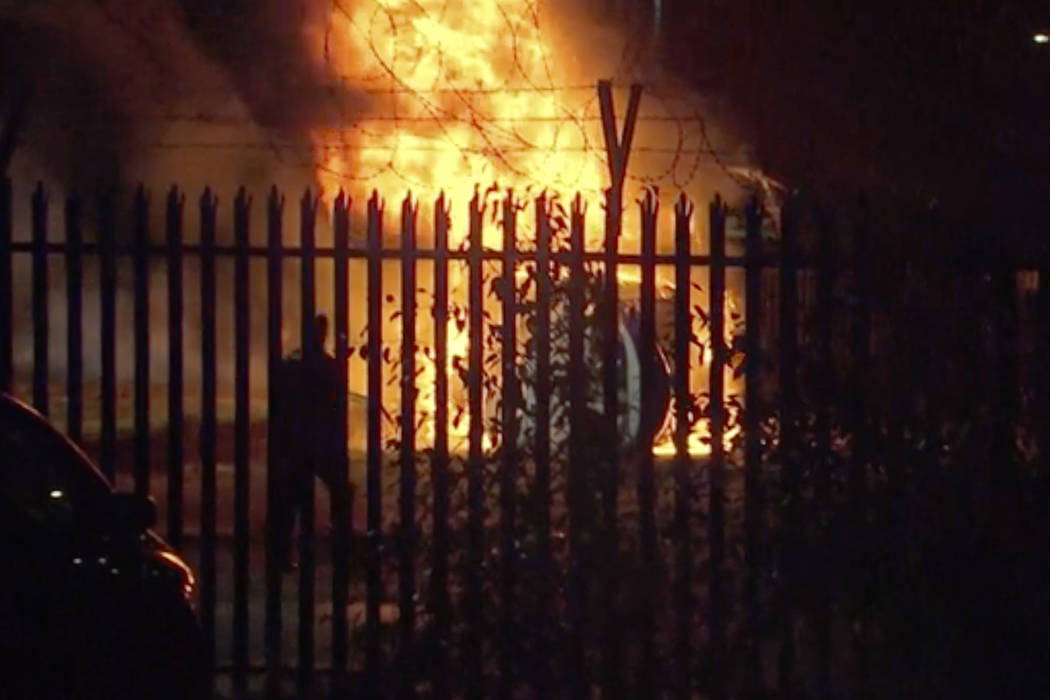 This image made from video shows a burning helicopter in a parking lot outside the King Power Stadium in Leicester, England shortly after a Premier League game on Saturday, Oct. 27, 2018. (Pool Ph ...