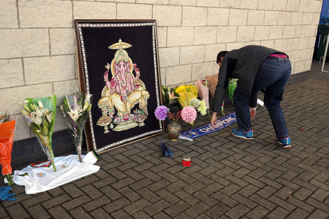 Flowers are seen outside Leicester City Football Club after a helicopter crashed in flames the day before, in Leicester, England, Sunday, Oct. 28, 2018. A helicopter belonging to Leicester City's ...