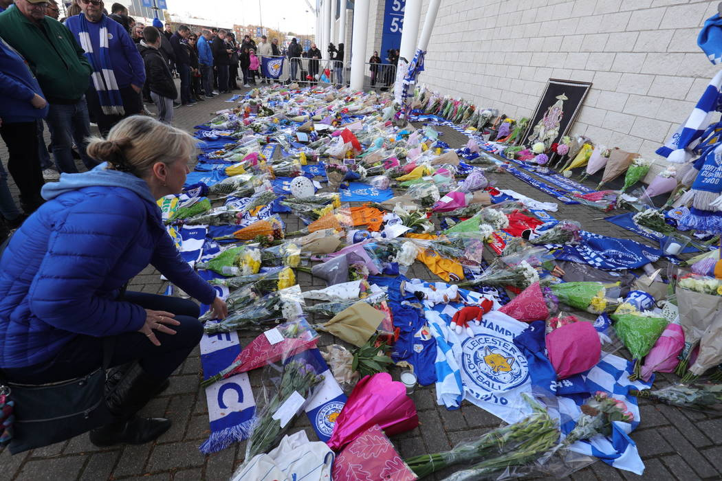 Flowers are placed outside Leicester City Football Club after a helicopter crashed in flames the previous day, in Leicester, England, Sunday, Oct. 28, 2018. A helicopter belonging to Leicester Cit ...