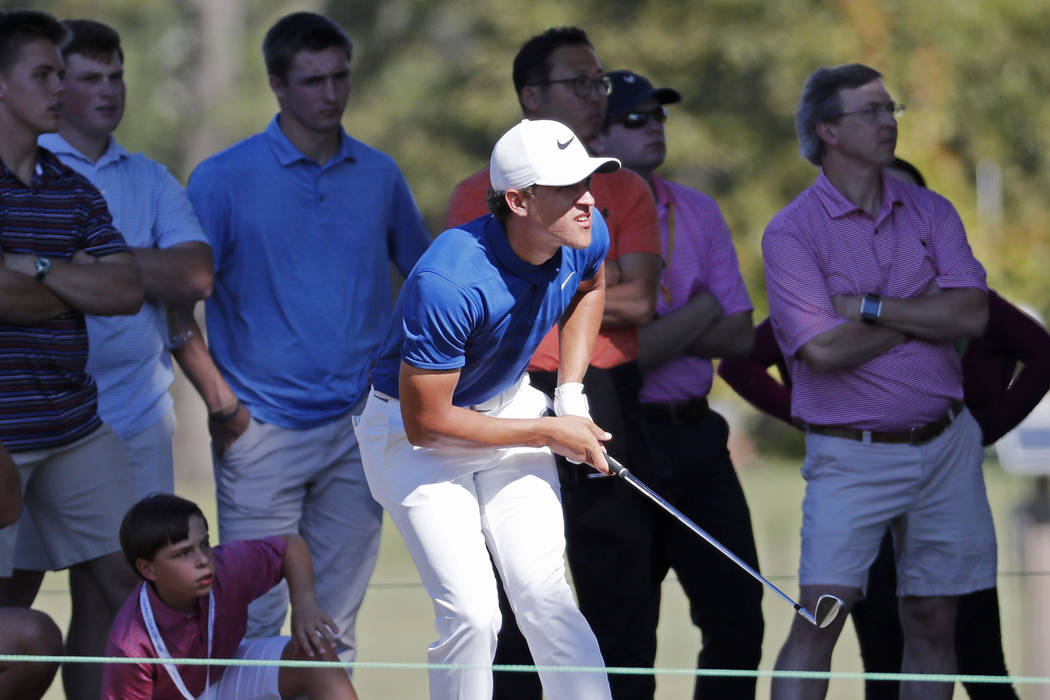 Cameron Champ urges his drive from the rough on the first fairway during the final day of the Sanderson Farms Championship golf tournament in Jackson, Miss., Sunday, Oct. 28, 2018. (AP Photo/Rogel ...