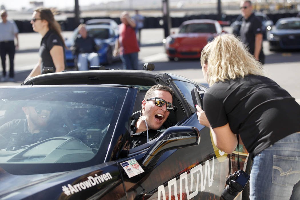 Corey Capece reacts after driving a car for the first time at an event for Driven, a new rehabilitation center to help people with disabilities that will be built in downtown Las Vegas at SpeedVeg ...