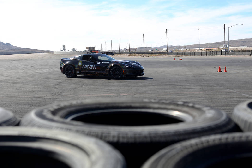Bradley Boe drives a car at an event for Driven, a new rehabilitation center to help people with disabilities that will be built in downtown Las Vegas at SpeedVegas in Las Vegas, Sunday, Oct. 28, ...