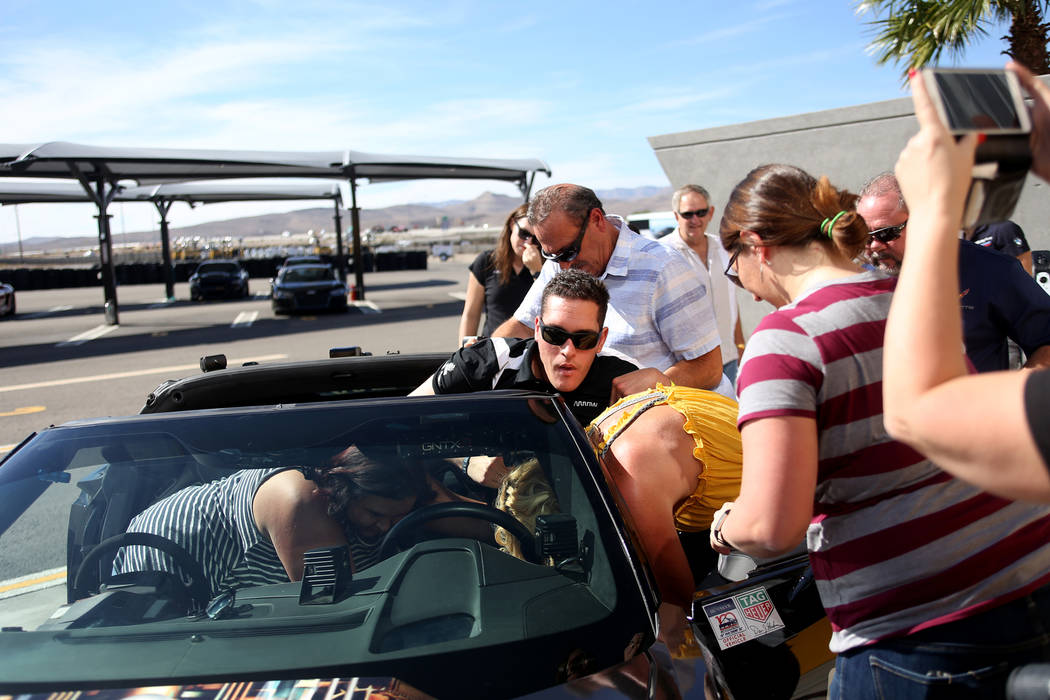 Friends and family assist Corey Capece at an event for Driven, a new rehabilitation center to help people with disabilities that will be built in downtown Las Vegas at SpeedVegas in Las Vegas, Sun ...