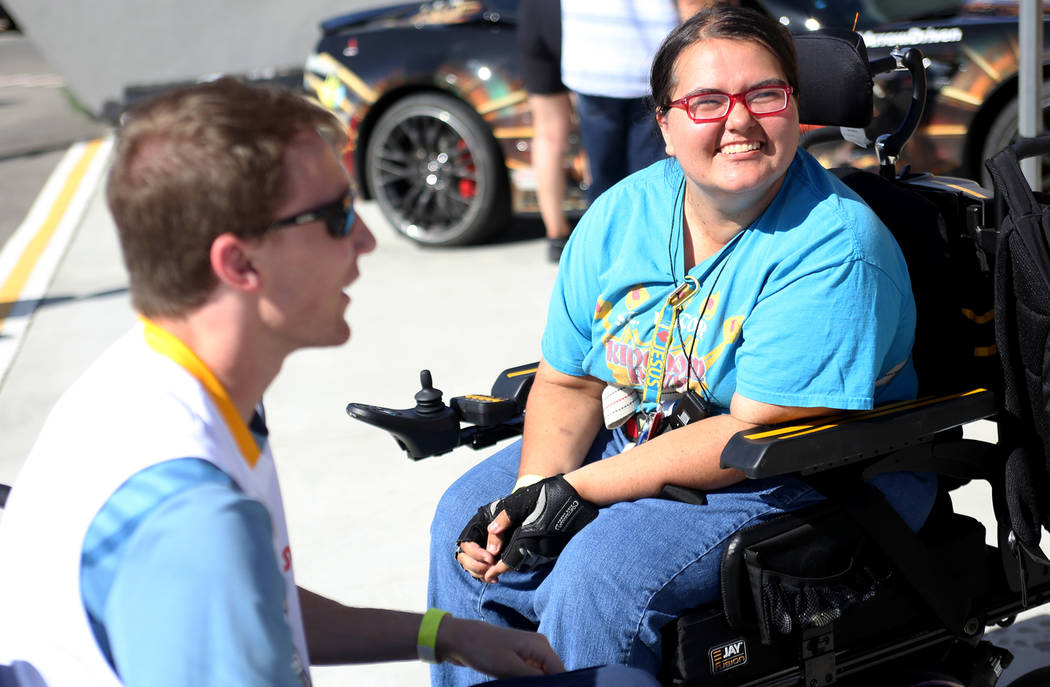 Madison Bowe, right, talks with Bradley Boe at an event for Driven, a new rehabilitation center to help people with disabilities that will be built in downtown Las Vegas at SpeedVegas in Las Vegas ...