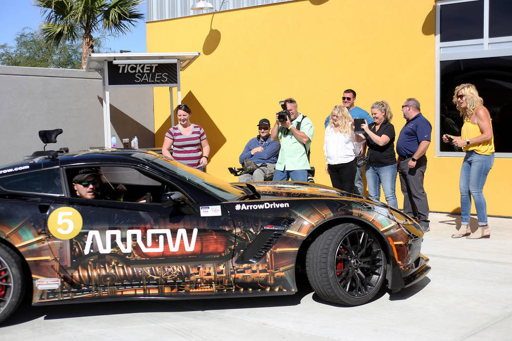 Friends and family watch Corey Capece drive away at an event for Driven, a new rehabilitation center to help people with disabilities that will be built in downtown Las Vegas at SpeedVegas in Las ...
