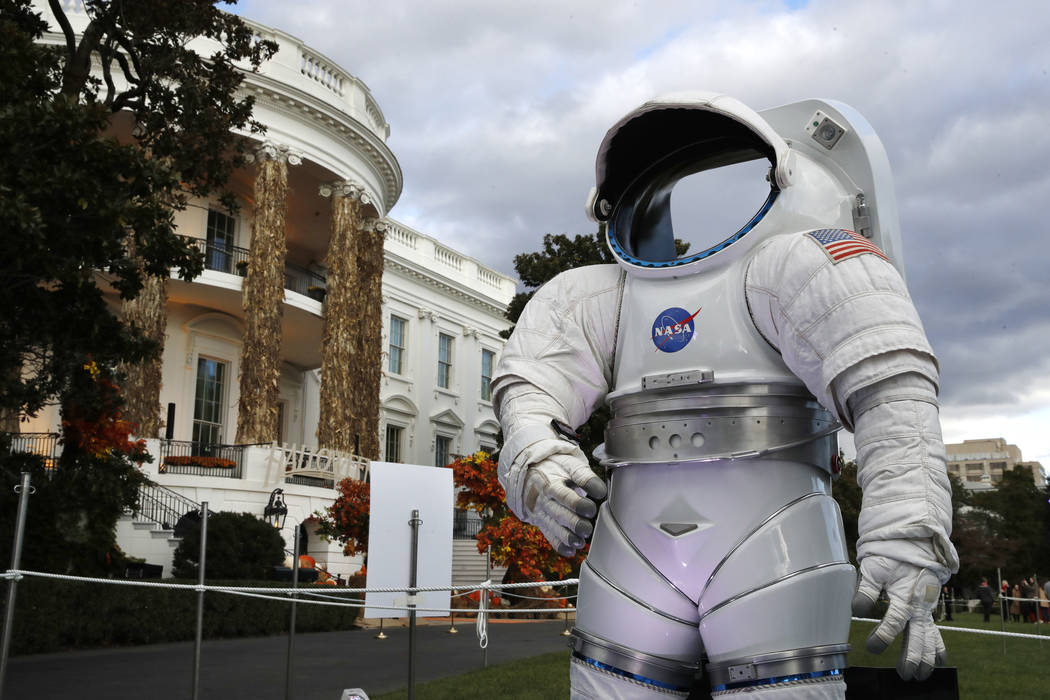 A space suit from NASA is on display among the decorations on the South Portico of the White House decorated for Halloween, Sunday, Oct. 28, 2018, in Washington. President Donald Trump and first l ...