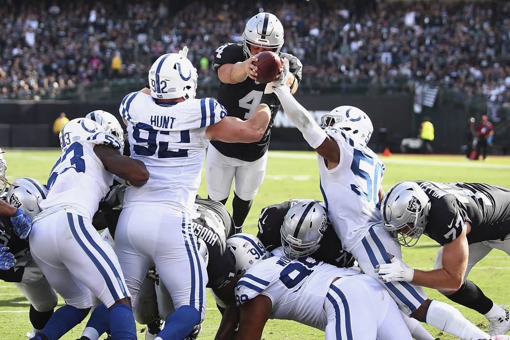 Oakland Raiders quarterback Derek Carr (4) dives for a touchdown against the Indianapolis Colts during the second half of an NFL football game in Oakland, Calif., Sunday, Oct. 28, 2018. (AP Photo/ ...