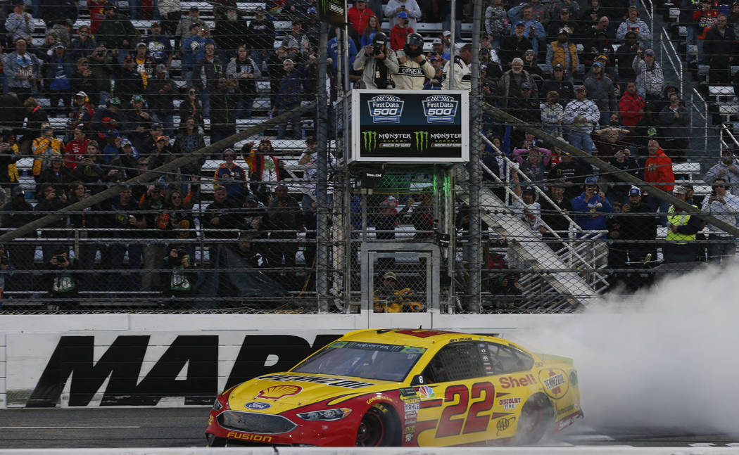 Joey Logano (22) does a burnout as he celebrates after winning the Monster Energy NASCAR Cup Series auto race at Martinsville Speedway in Martinsville, Va., Sunday, Oct. 28, 2018. (AP Photo/Steve ...