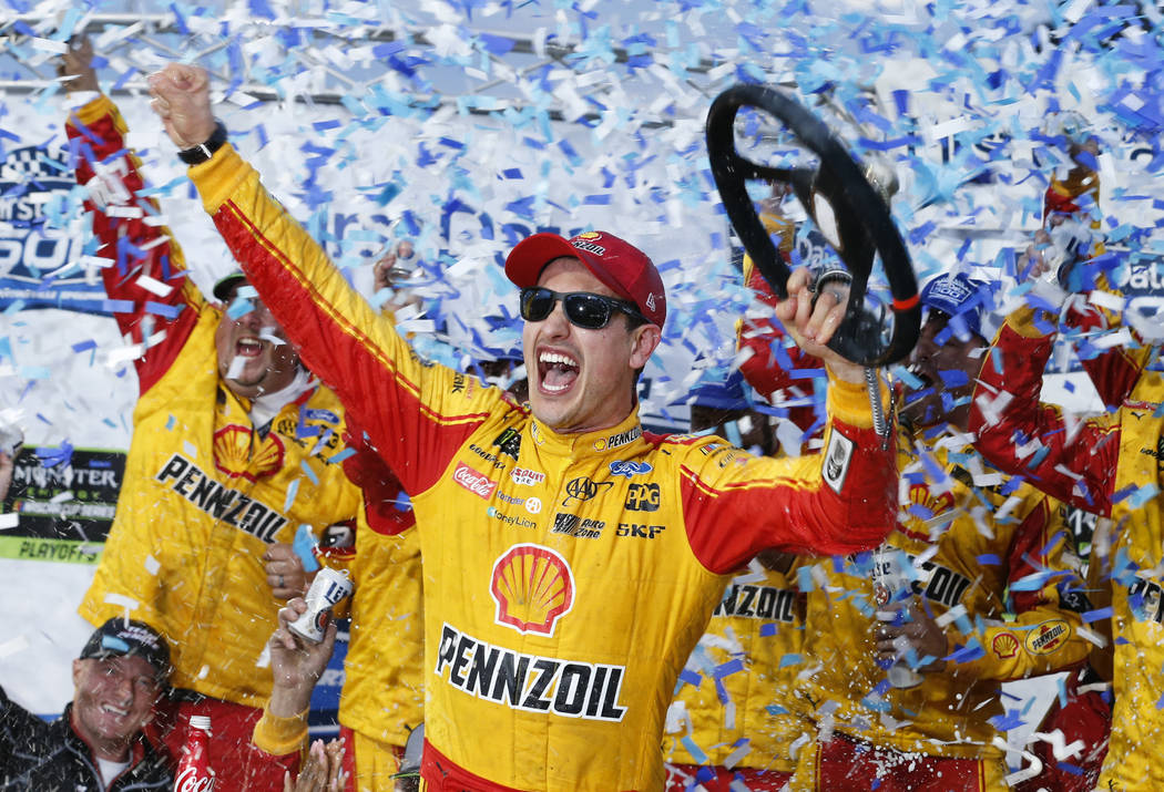 Joey Logano celebrates after winning the Monster Energy NASCAR Cup Series auto race at Martinsville Speedway in Martinsville, Va., Sunday, Oct. 28, 2018. (AP Photo/Steve Helber)