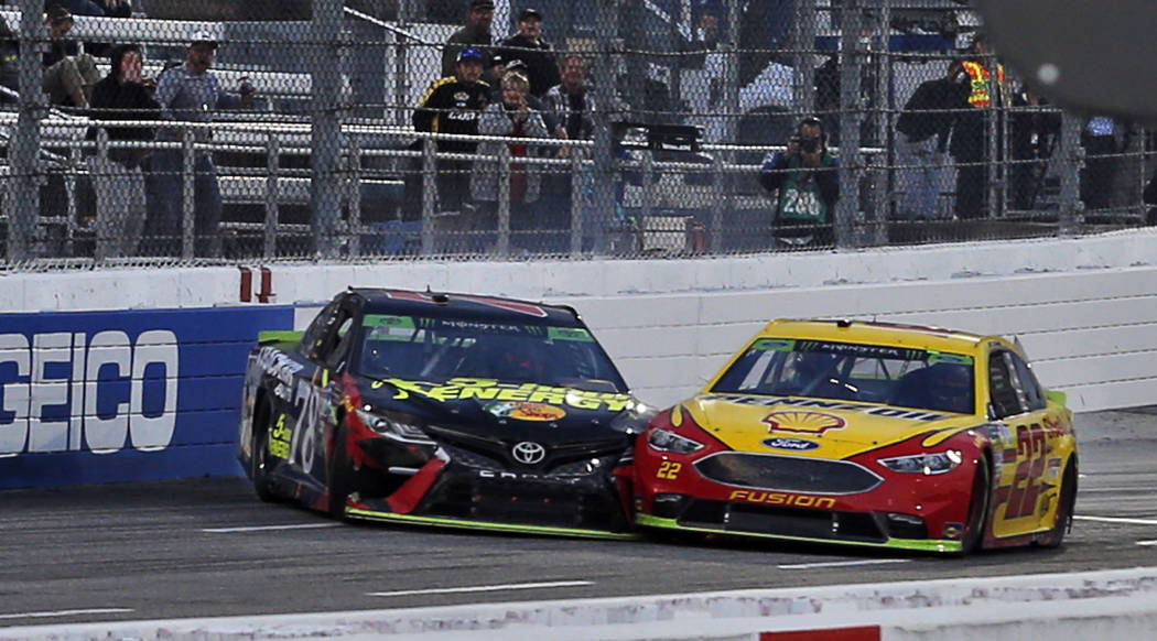 Joey Logano (22) and Martin Truex Jr. (78) make contact as they approach the finish line at the Monster Energy NASCAR Cup Series auto race at Martinsville Speedway in Martinsville, Va., Sunday, Oc ...