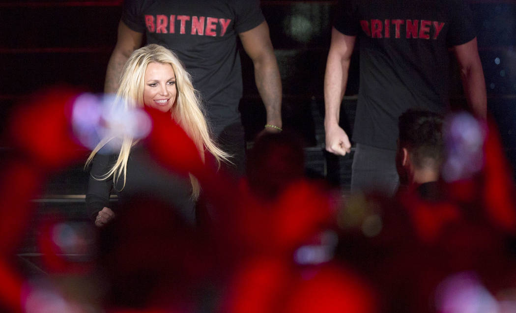Britney Spears signs autographs during an event to announce her new residency at The Park Theater at Park MGM on Thursday, Oct. 18, 2018, outside T-Mobile Arena, in Las Vegas. Benjamin Hager ...