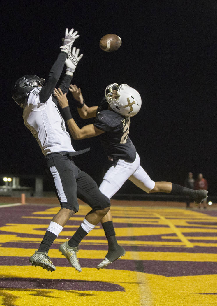 Faith Lutheran senior defensive back Gregory Oliver (20) defends Palo Verde senior wide receiver Karsonne Winters (11) in the first quarter on Friday, Oct. 19, 2018, at Faith Lutheran High School, ...