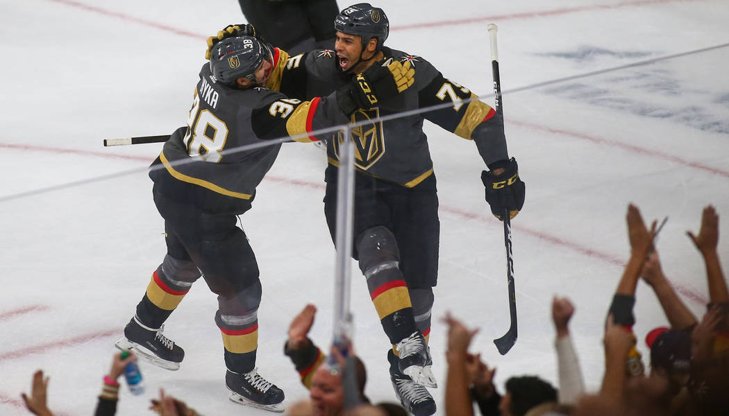 Golden Knights right wing Tomas Hyka (38) and Ryan Reaves (75) celebrate the Golden Knights' second goal of the game during the second period of an NHL hockey game at T-Mobile Arena in Las Vegas, ...