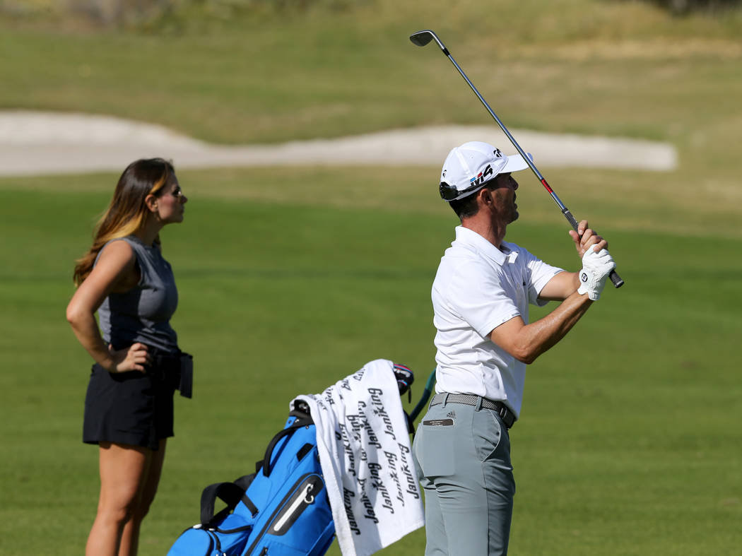 Former Masters champion Mike Weir watches his approach shot on hole one during the Shriners Hospital for Children Open qualifier at Boulder Creek Golf Cub in Boulder City Monday, Oct. 29, 2018. We ...