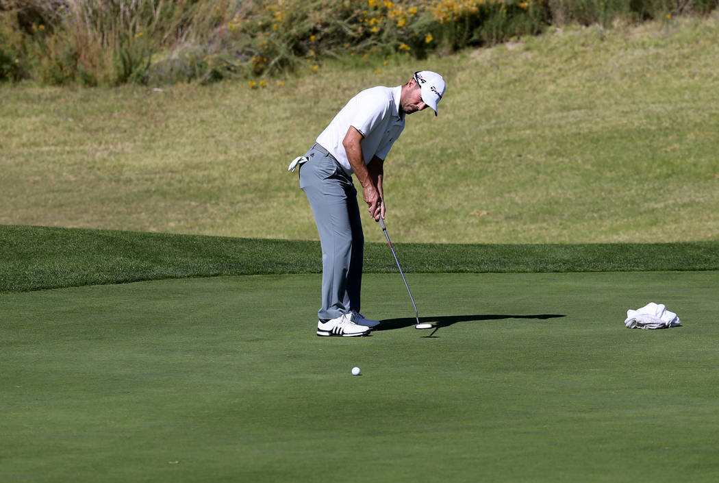 Former Masters champion Mike Weir putts on hole one during the Shriners Hospital for Children Open qualifier at Boulder Creek Golf Cub in Boulder City Monday, Oct. 29, 2018. Weir's caddy is his gi ...