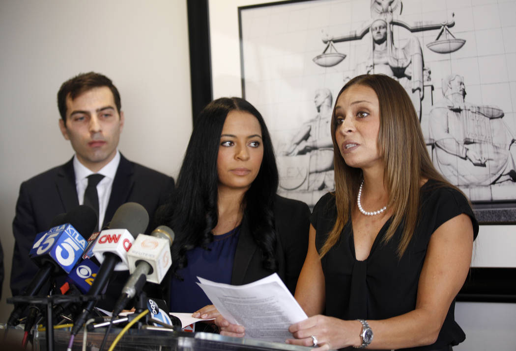 Jordan Cobbs addresses the media next to her sister, Tasha Schwikert-Warren, at the offices of Panish Shea & Boyle in Los Angeles on Monday, Oct. 29, 2018. The sisters came forward with their acco ...