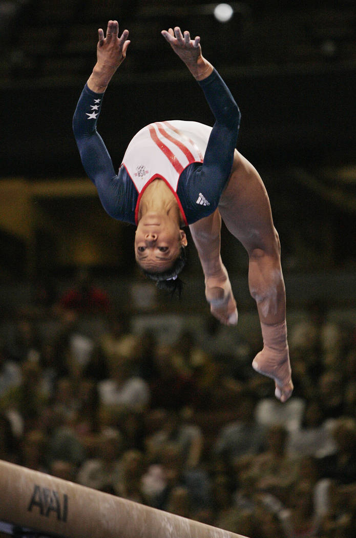 Tasha Schwikert of Las Vegas performs on the balance beam during preliminaries at the U.S. Olympic gymnastics trials in Anaheim, Calif. in 2004. (AP Photo/Kevork Djansezian)