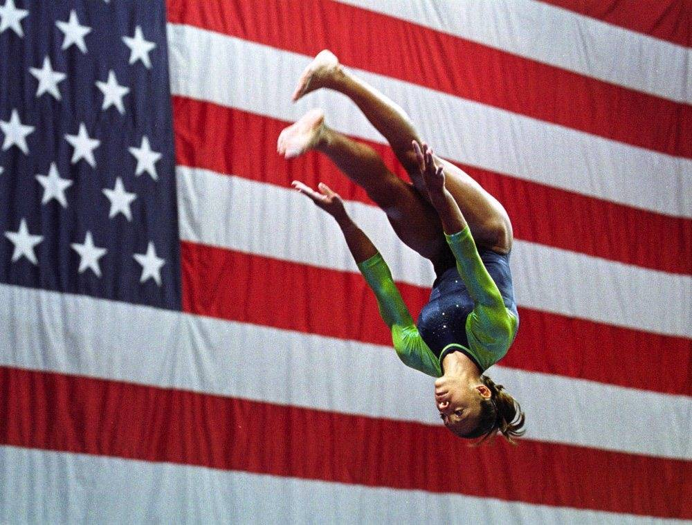 Tasha Schwikert of Las Vegas, performs her balance beam routine during the U.S. Gymnastics Championships in Philadelphia in 2001. Schwikert won the overall competition. (AP Photo/Chris Gardner)