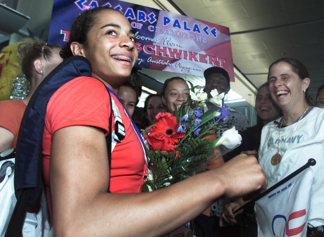 Tasha Schwikert smiles as she is greeted by family and friends including her mother at far right in 2000. (Review-Journal File Photo)