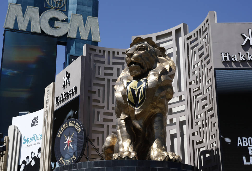 A giant puck promoting the Vegas Golden Knights displayed outside the MGM Grand next to Leo the lion at the intersection of Flamingo Road and Las Vegas Boulevard South in Las Vegas on Monday, May ...