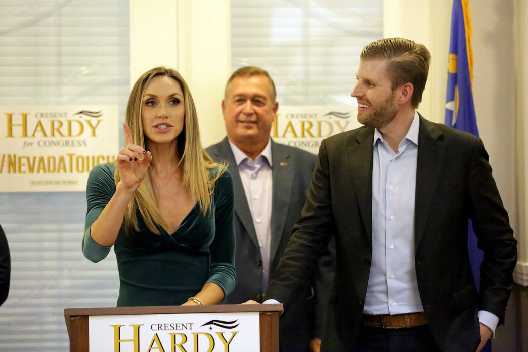 Lara Trump addresses a crowd during a rally at the Nevada Republican Party's Summerlin office as her husband Eric Trump, right, and Cresent Hardy listen on Monday, October 29, 2018. Michael ...