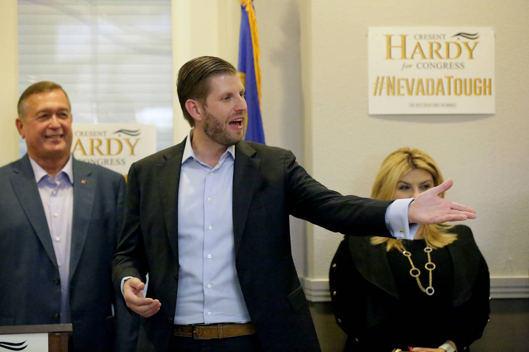 Eric Trump, center, responds to comments from the crowd during a rally at the Nevada Republican Party's Summerlin office as Cresent Hardy and Michele Fiore watch on Monday, October 29, 2018 ...