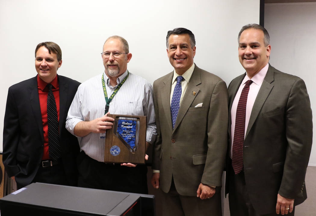 Richard Knoeppel, second left, an architectural design instructor at Advanced Technologies Academy, poses for a photo with Principal Jonathan Synold, left, Gov. Brian Sandoval and Clark County Sc ...