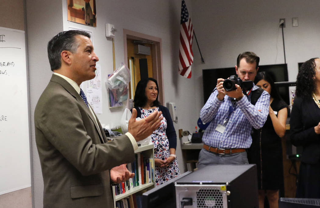 Gov. Brian Sandoval speaks after a surprise visit to the Advanced Technologies Academy to name Richard Knoeppel, an architectural design instructor, the 2018 Nevada Teacher of the Year on Monday, ...