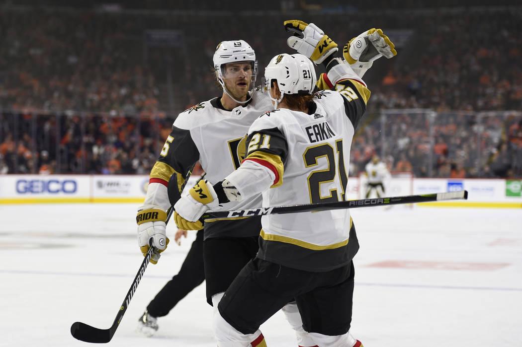 Vegas Golden Knights' Cody Eakin (21) celebrates with Jon Merrill after Eakin scored a goal during the third period of an NHL hockey game on Philadelphia Flyers goaltender Brian Elliott, Saturday, ...