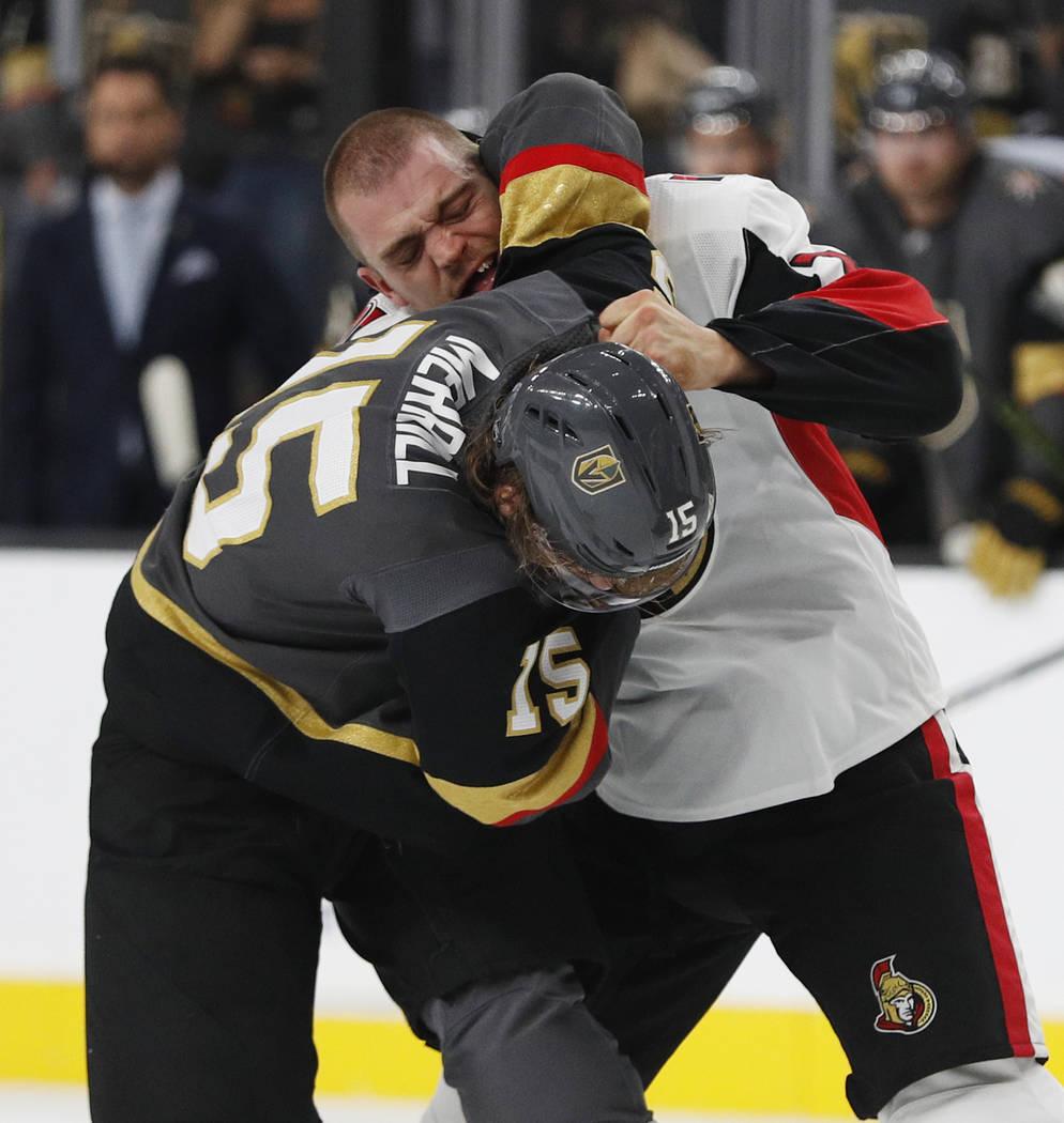 Vegas Golden Knights defenseman Jon Merrill (15) fights with Ottawa Senators defenseman Mark Borowiecki (74) during the first period of an NHL hockey game Sunday, Oct. 28, 2018, in Las Vegas. (AP ...