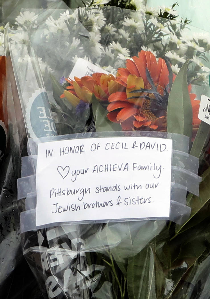 A note honoring shooting fatalities and brothers Cecil and David Rosenthal sits at a memorial at the Tree of Life Synagogue in Pittsburgh, Sunday, Oct. 28, 2018. Robert Bowers, the suspect in Satu ...