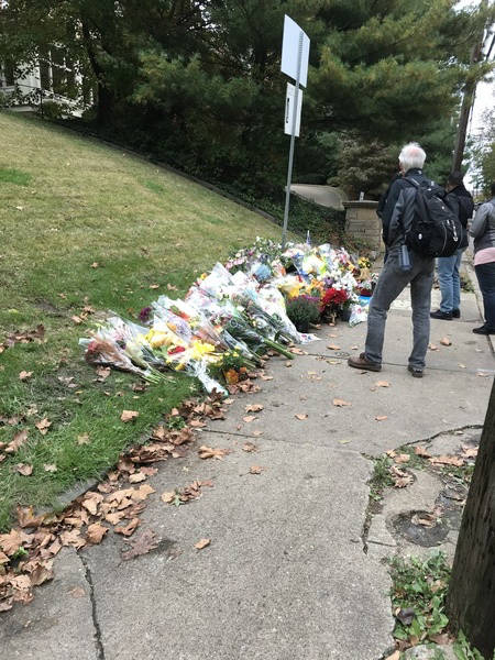 A resident of the Squirrel Hill neighborhood, Robert O'Doherty paid respects at a memorial for the victims of the synagogue shooting in Pittsburgh. The dreary weather matched the mood of Pi ...