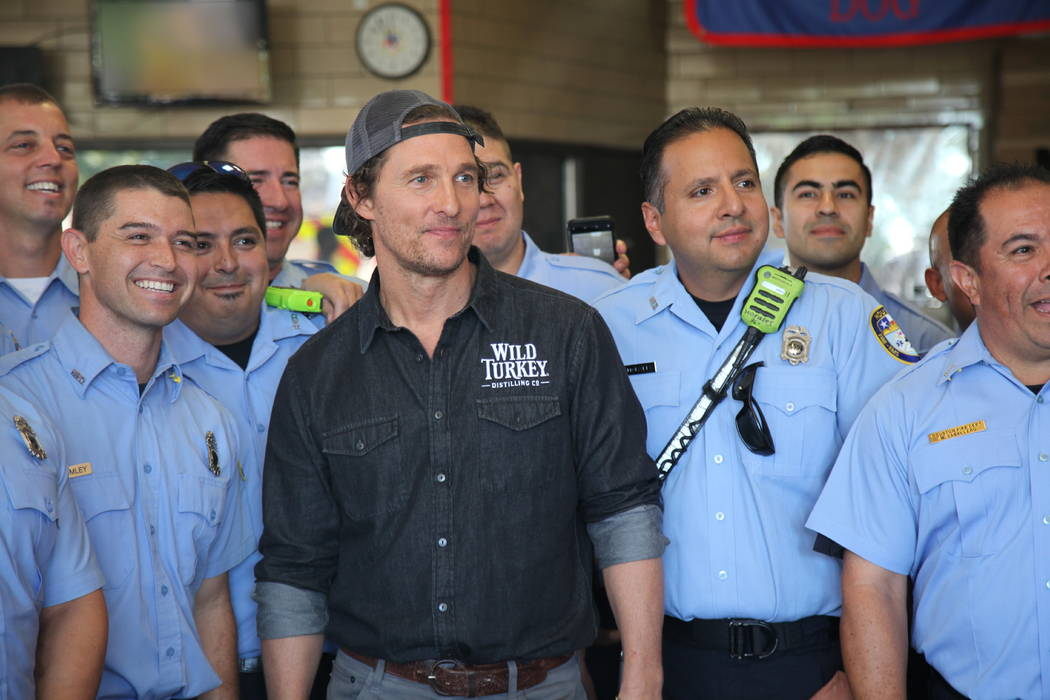 This Oct. 28, 2018 photo shows actor Matthew McConaughey posing with first responders in Houston as he surprised them with catered lunches. McConaughey said he wanted to celebrate National First R ...