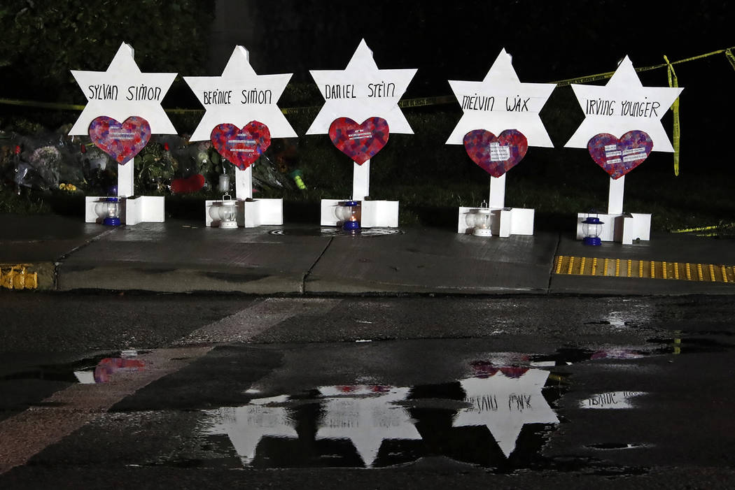 These Stars of David with the names of five of the 11 people killed at the Tree of Life Synagogue part of a memorial of flowers and stars that have collected outside the temple, Sunday, Oct. 28, 2 ...