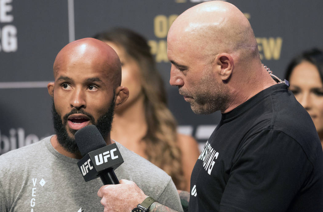 UFC flyweight champion Demetrious Johnson, left, is interviewed by Joe Rogan at the T-Mobile Arena during the UFC 216 ceremonial weigh-ins in Las Vegas, Friday, Oct. 6, 2017. Heidi Fang Las Vegas ...